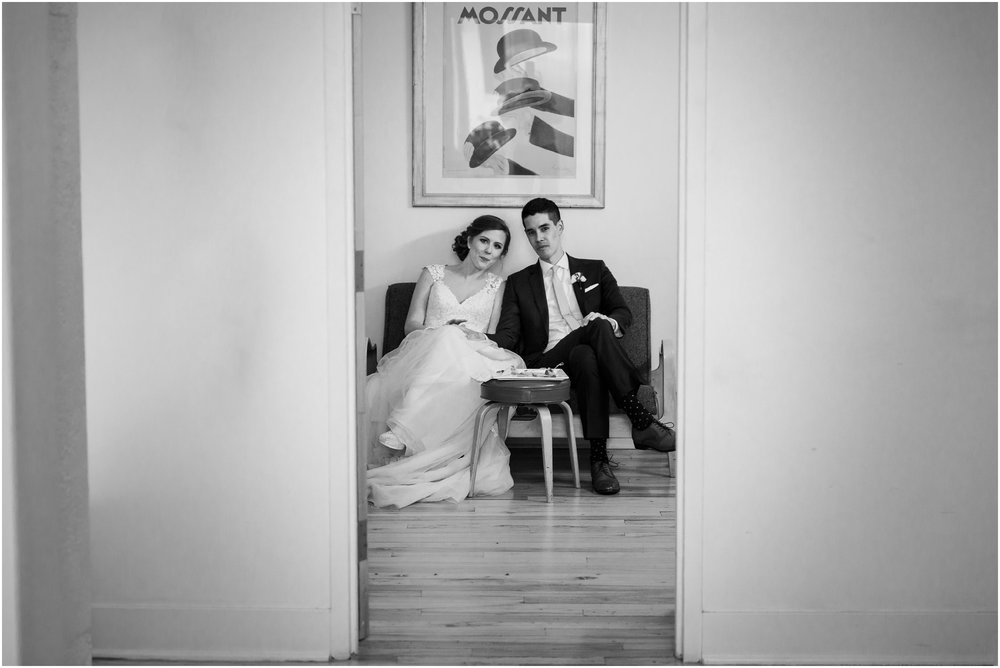 bride and groom sitting in bridal room after ceremony