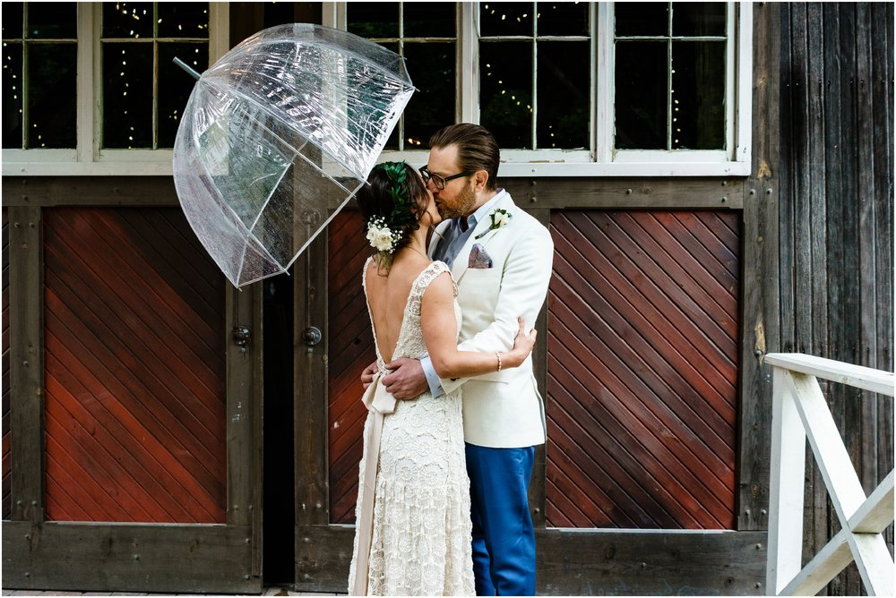 bride and groom kissing after first look