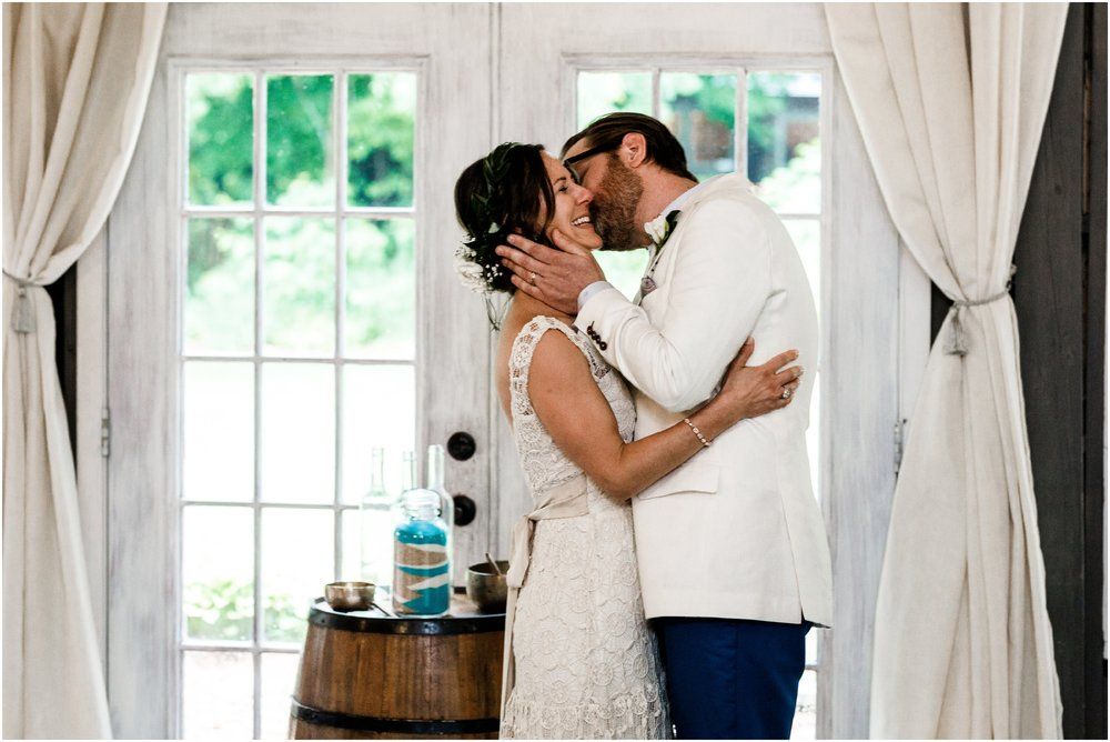 bride and groom's first kiss during ceremony