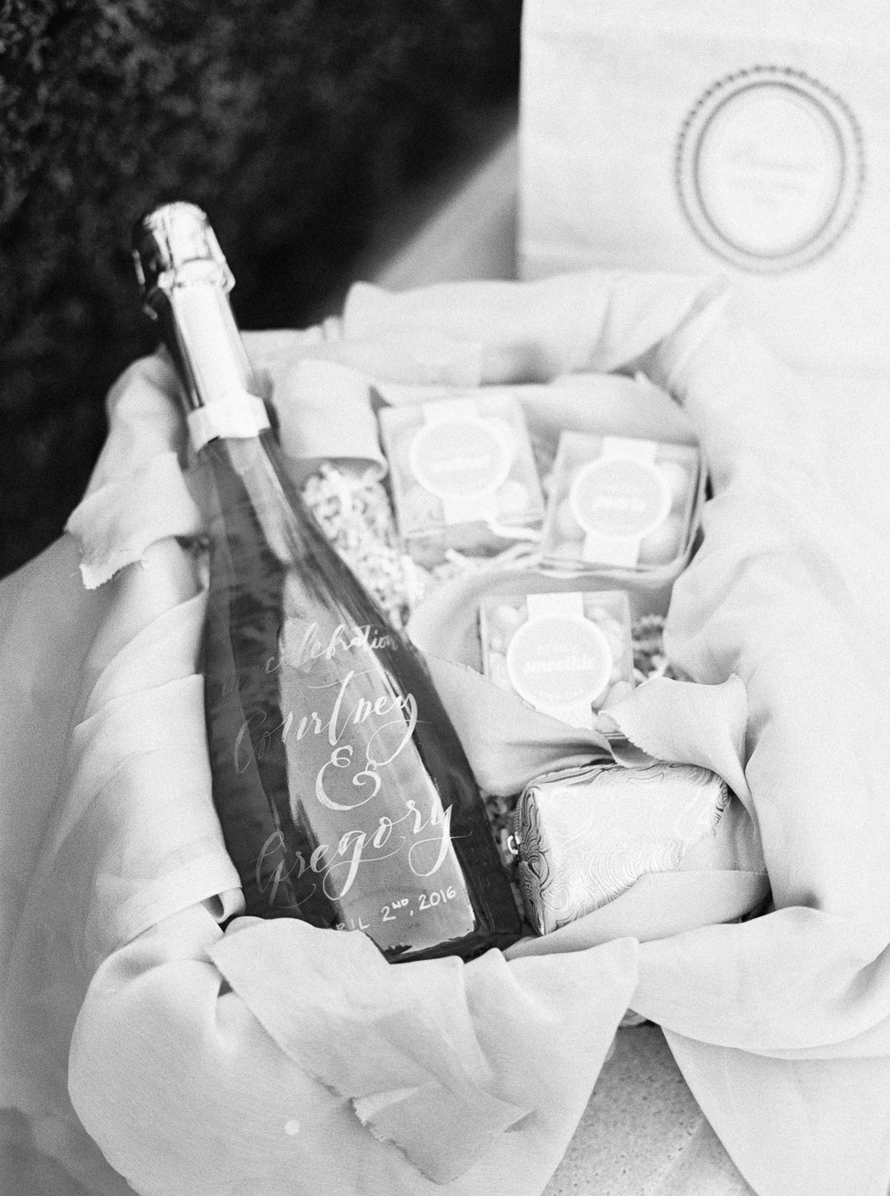Bridesmaid gift basket with handwritten calligraphy on Champagne bottle | by Lara Lam photography