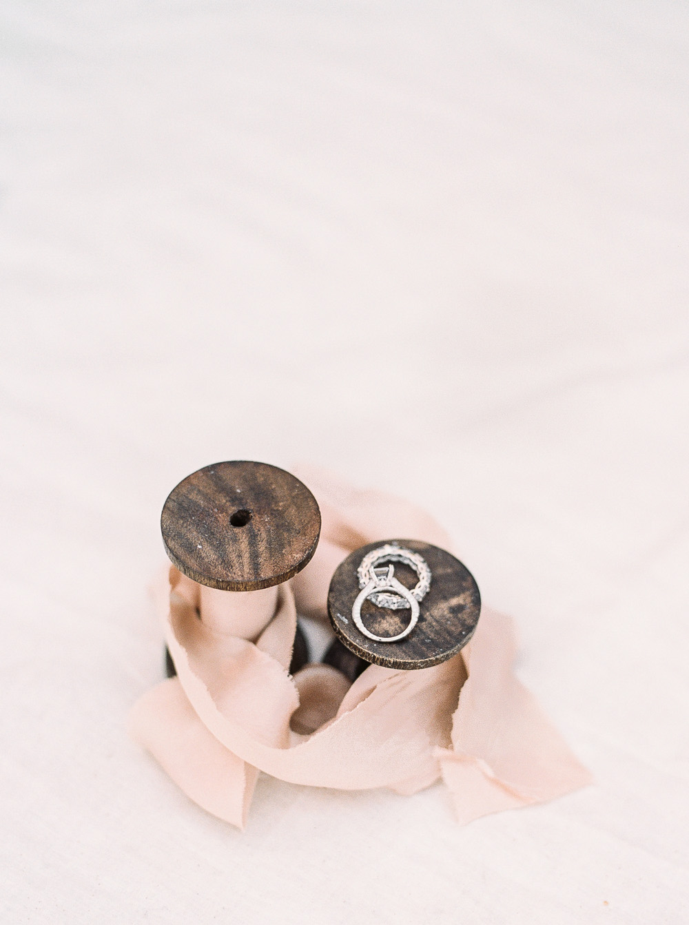 Ring shot on blush silk and willow ribbons | by Lara Lam photography