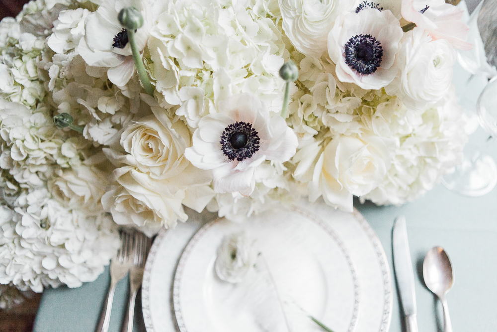 white roses and anemone flower centerpiece reception decor ideas