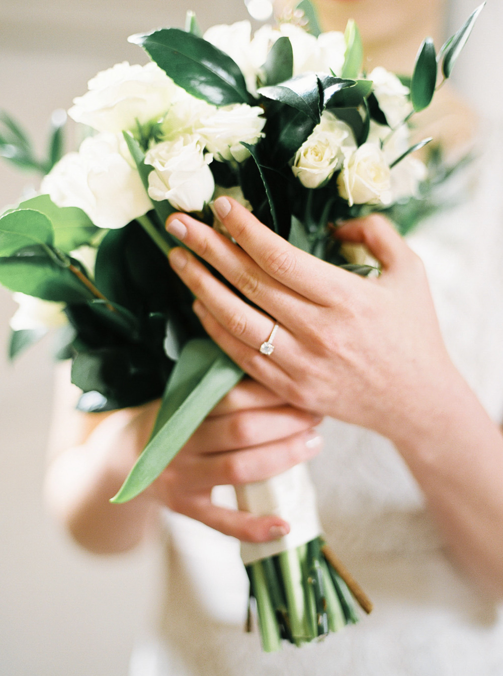 organic green wedding white rose bouquet with simple elegant diamond ring