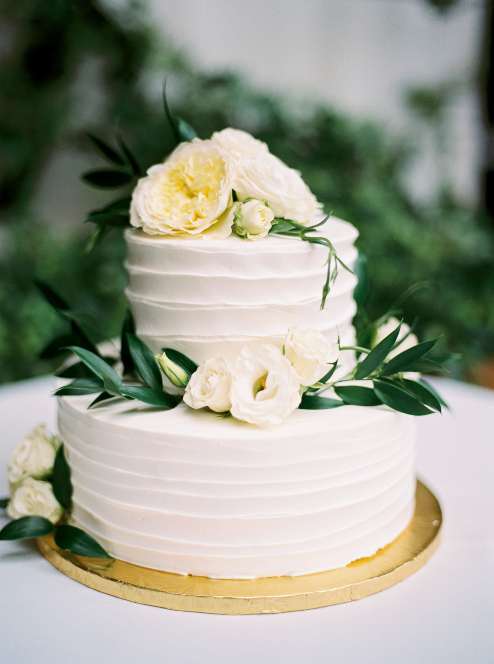 simple natural organic white wedding cake with fresh flowers green wedding