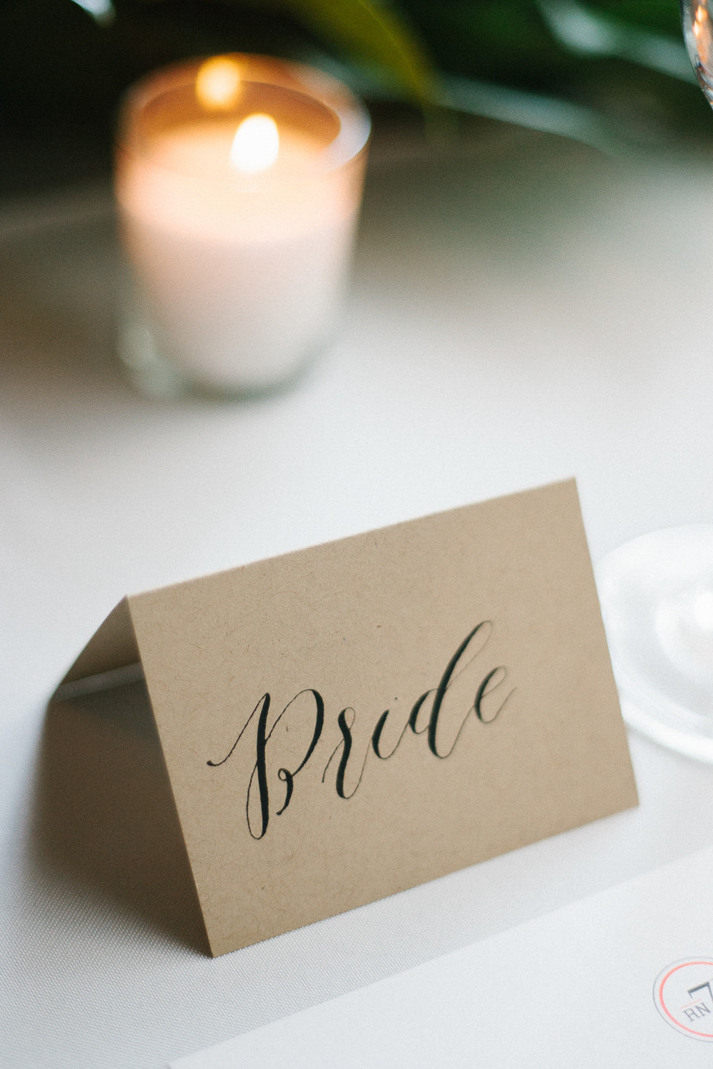 neutral organic reception decor idea calligraphy place card