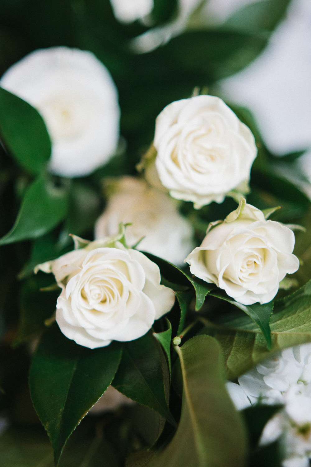 neutral organic reception decor idea white roses floral arrangement