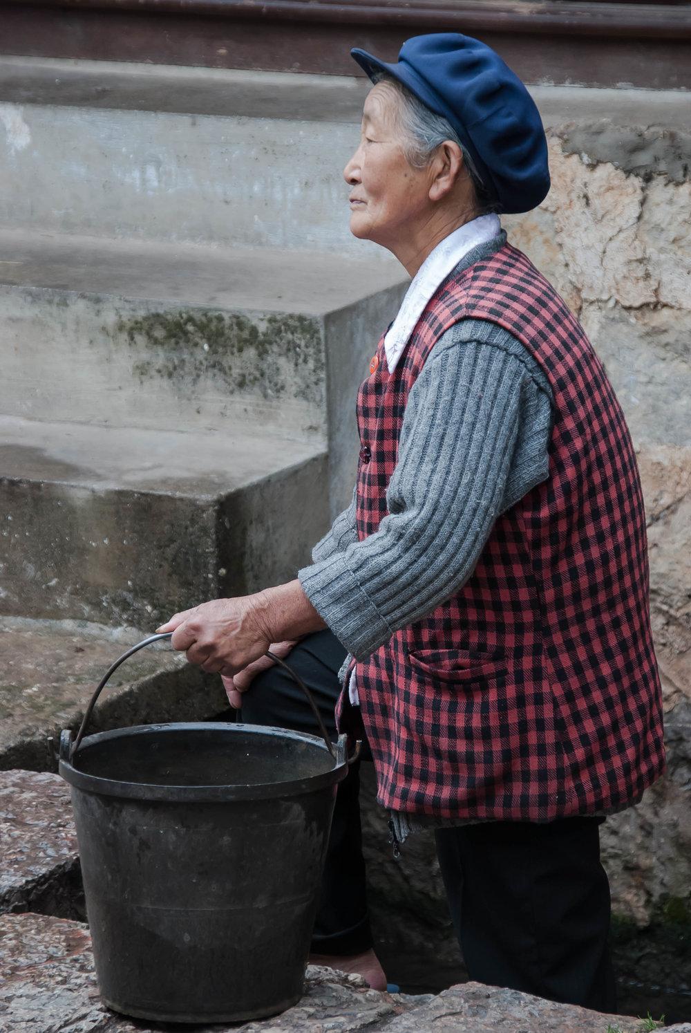2008_06-26 Old Woman Fetching Water Lijiang Yunnan China_.jpg