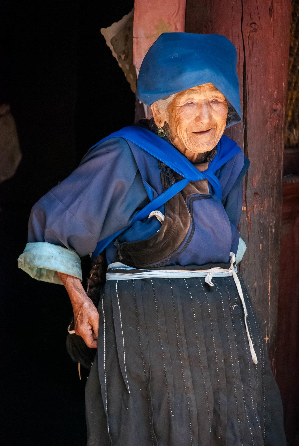 2008_06-26 Old Woman at Home Lijiang Yunnan China_.jpg