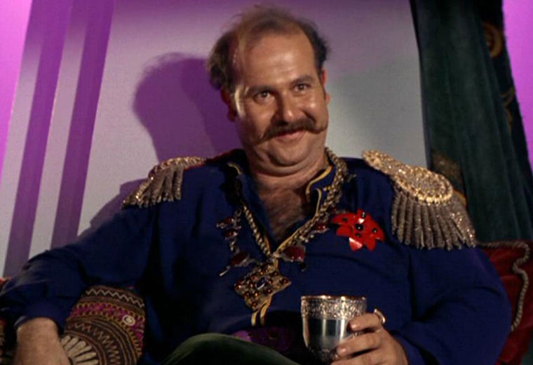 Roger C. Carmel  is Cyclonus, probably best known as Harry Mudd on Star Trek the original series.