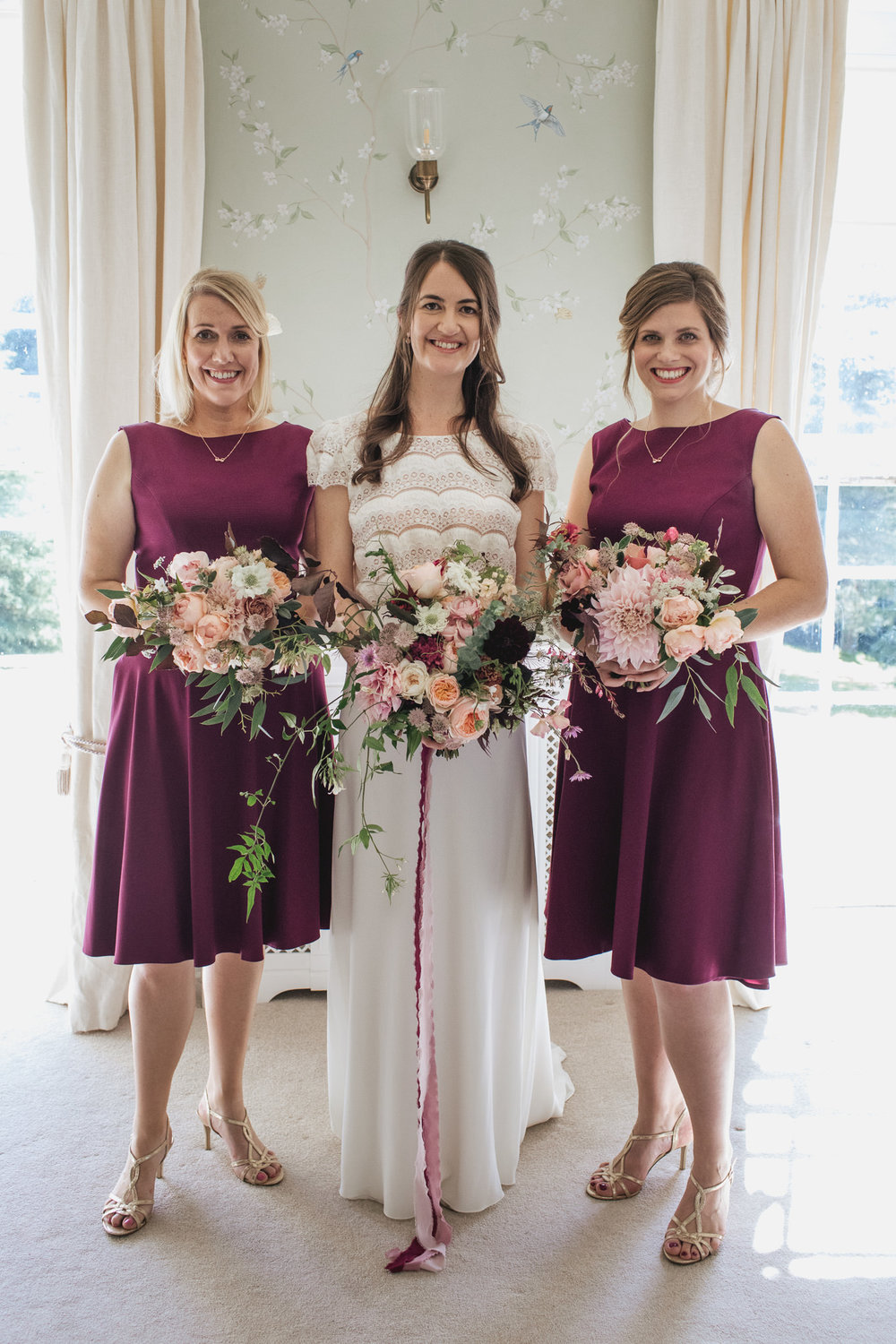 Emma's bouquet lovingly created by her talented florist mum Susan.  Bridesmaids bouquets created by Moss & Stone Floral Design.