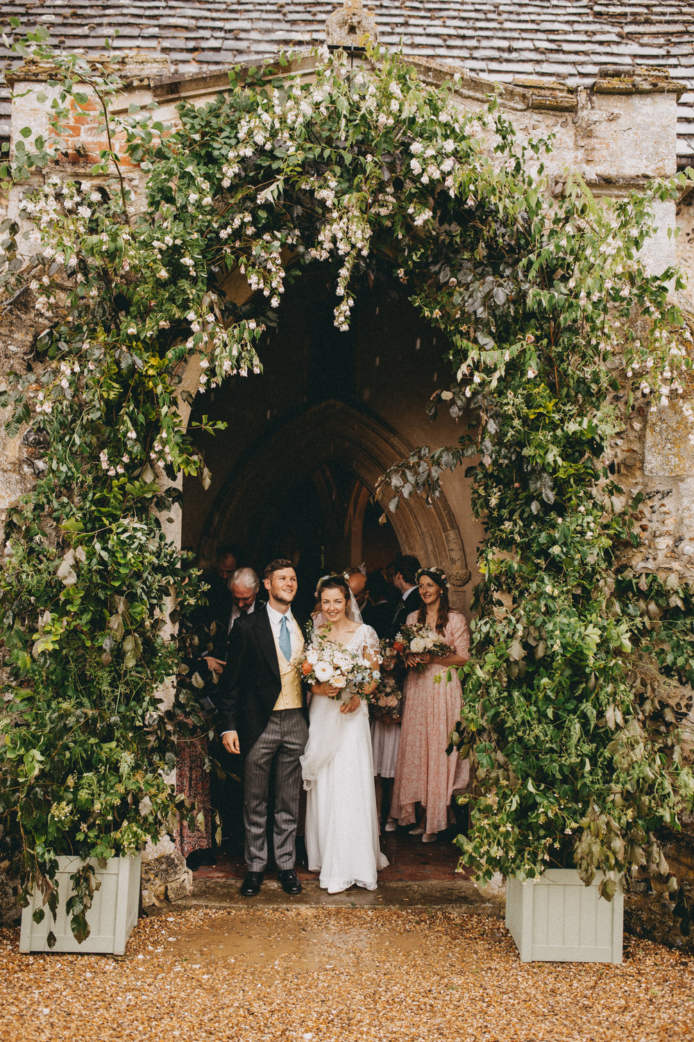 My goodness it rained as Poppy & Henry tried to leave the church  Image - Ali Paul Photographer