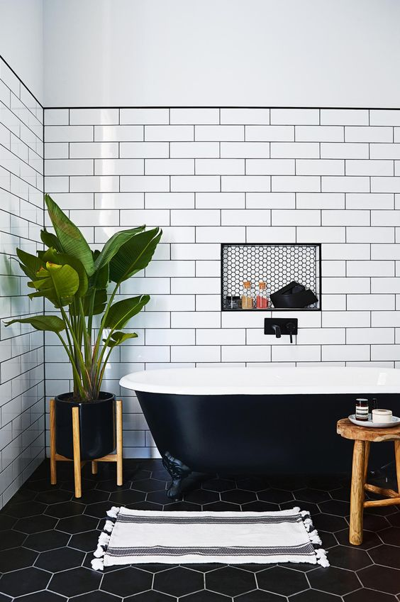 White wall tiles appear to bring the space out more.