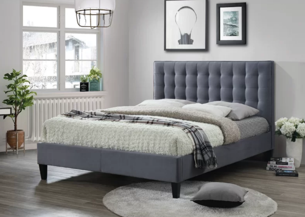 The Cortinas bed has a sprung slatted base and suede headboard. Image via Wayfair.