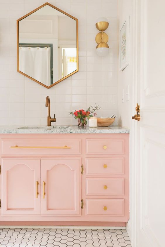 Elsie's guest bathroom features the winning blush & gold combination and I've always intended on using gold fixings in my own bathroom. Love the detail here.