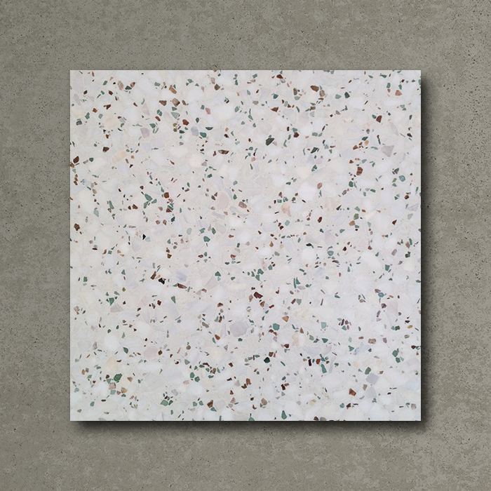 This more neutral terrazzo floor tile by Otto Tiles is closer to what I'd be looking for in my bathroom.  I like the fact that this design has a little twinge of peach in it too.