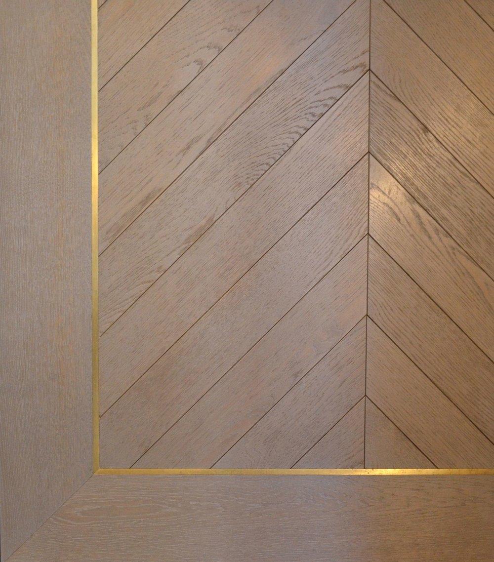 Oak Chevron Flooring with brass inlay
