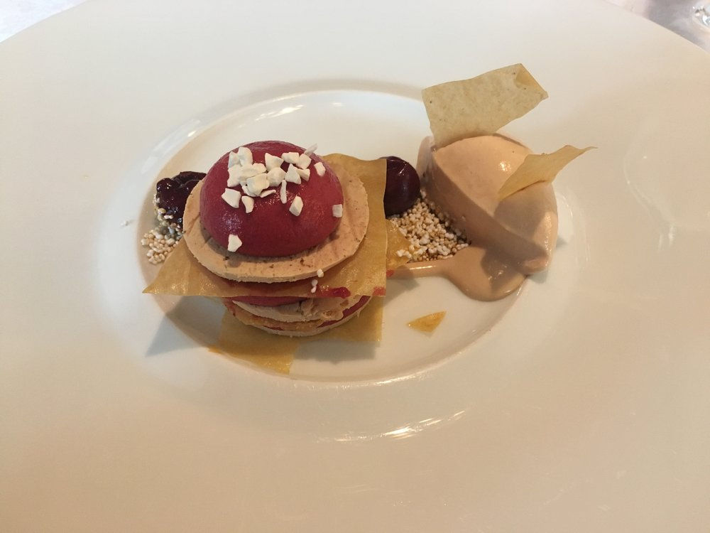 First course: Millefeuille from the goose liver with sour cherry and Amaranth