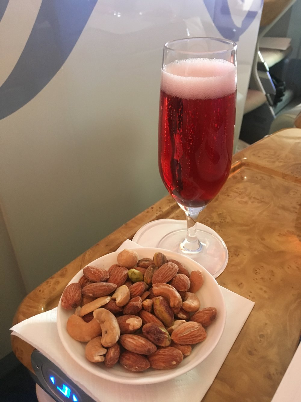 A Kir Royal and some nuts