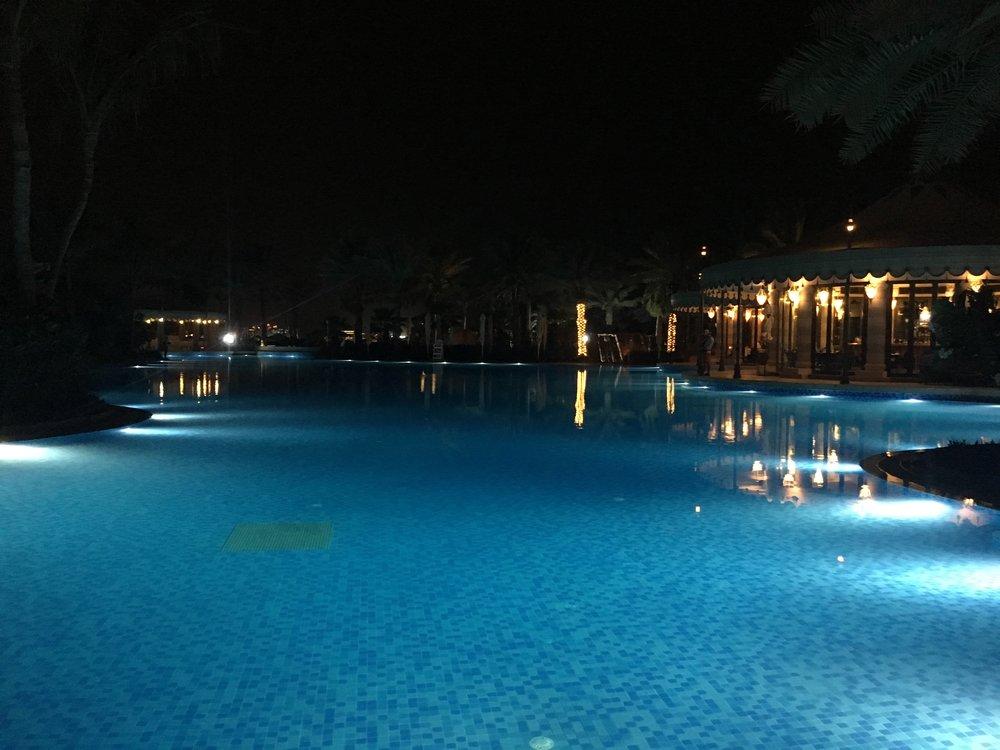 Night view of the Al Qasr pool