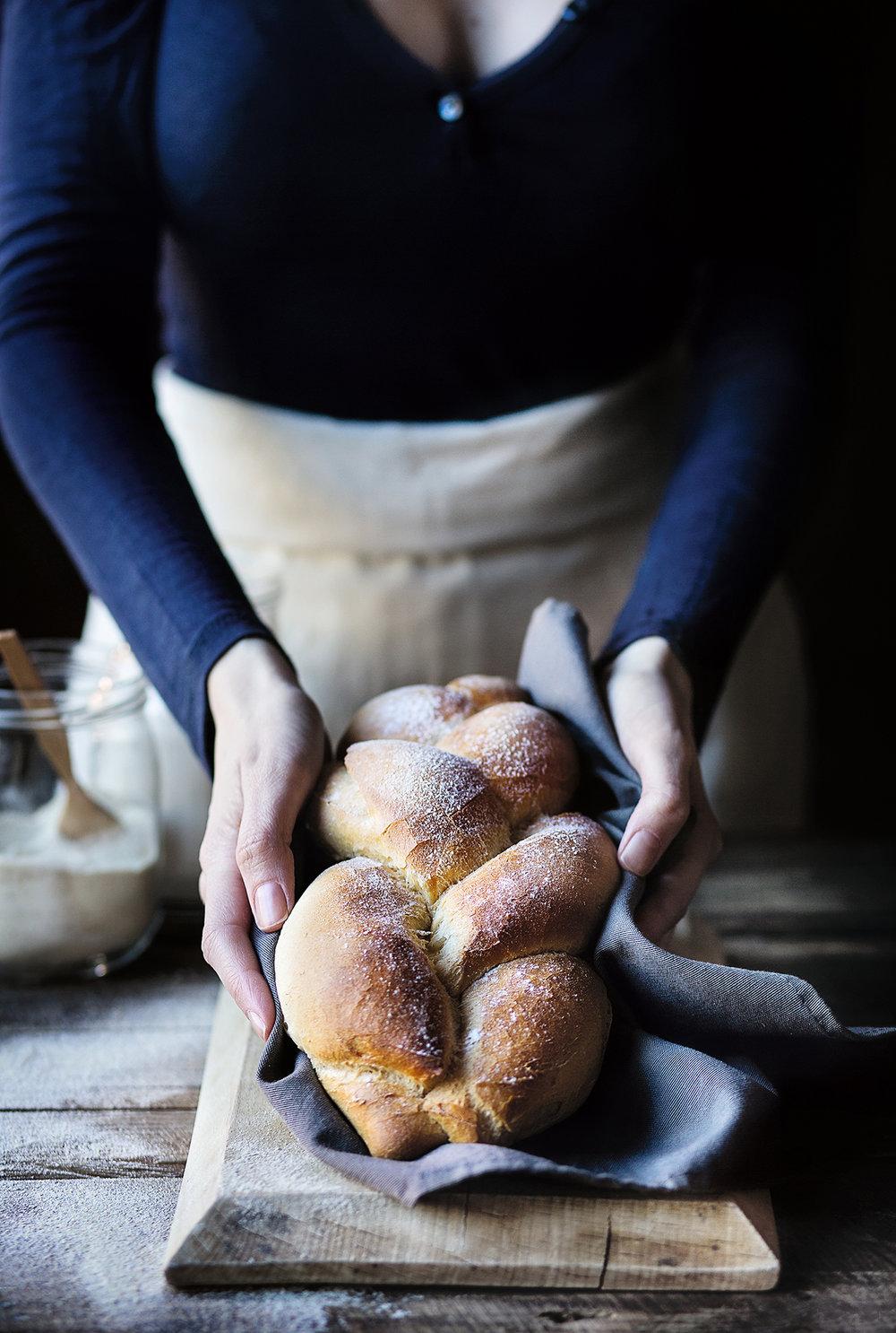 Copy of Woman holding fresh braided bread