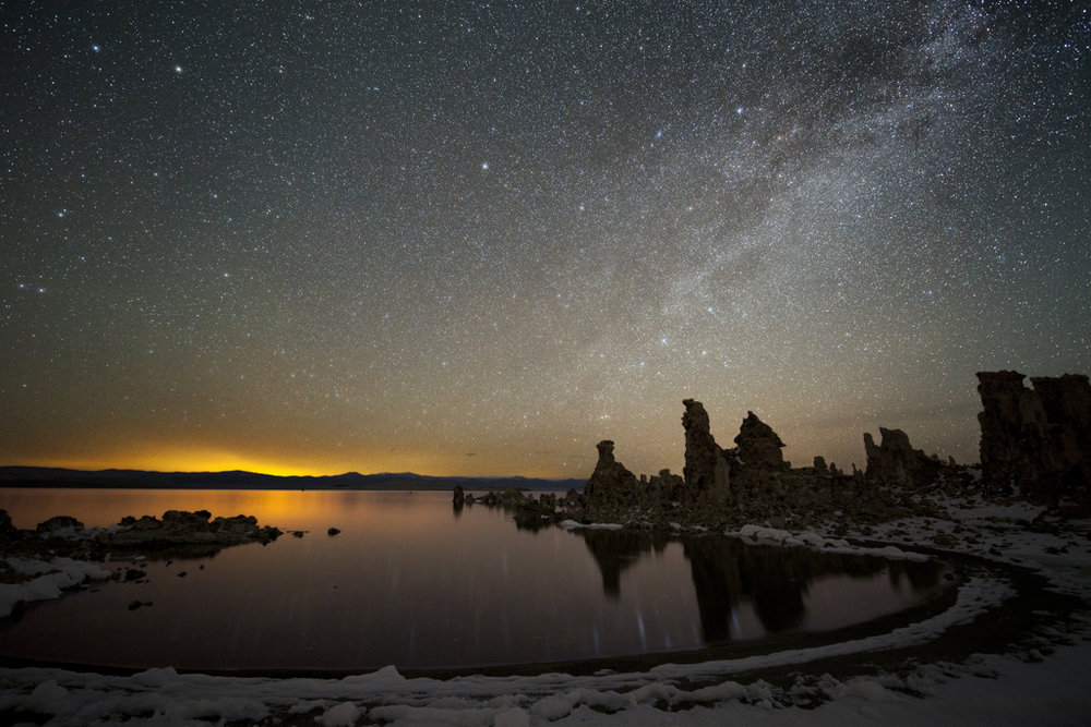 The Milky Way crosses the nighttime sky over Mono Lake