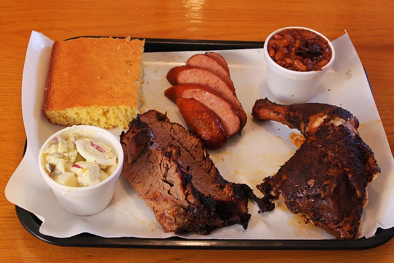 The sample platter at Holy Smoke BBQ will treat you right! ( holysmoketexasstylebbq.com )