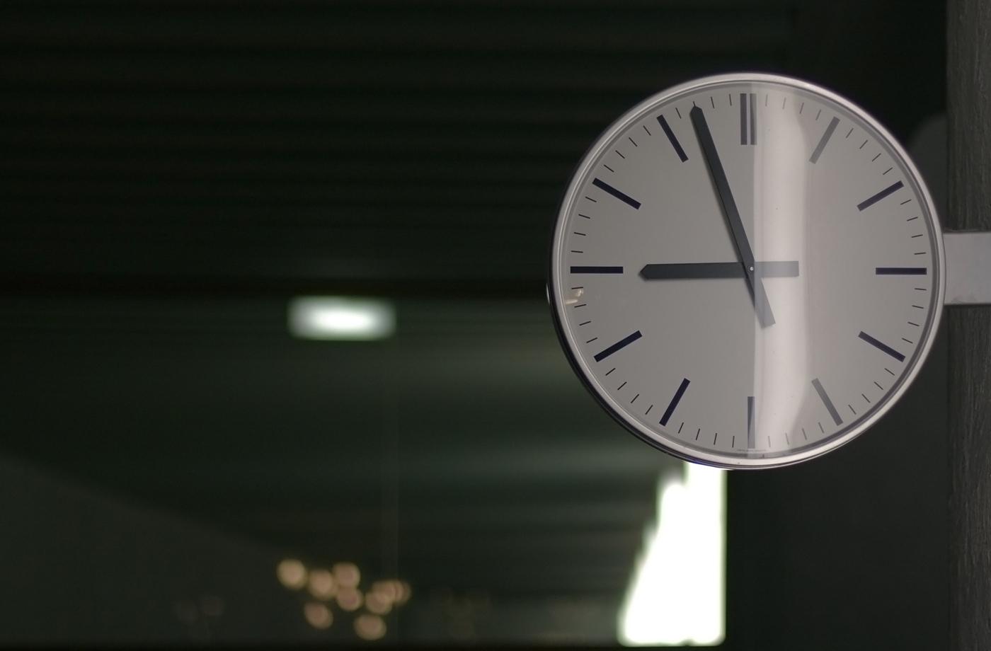 Clock In A Schoolhouse Corridor