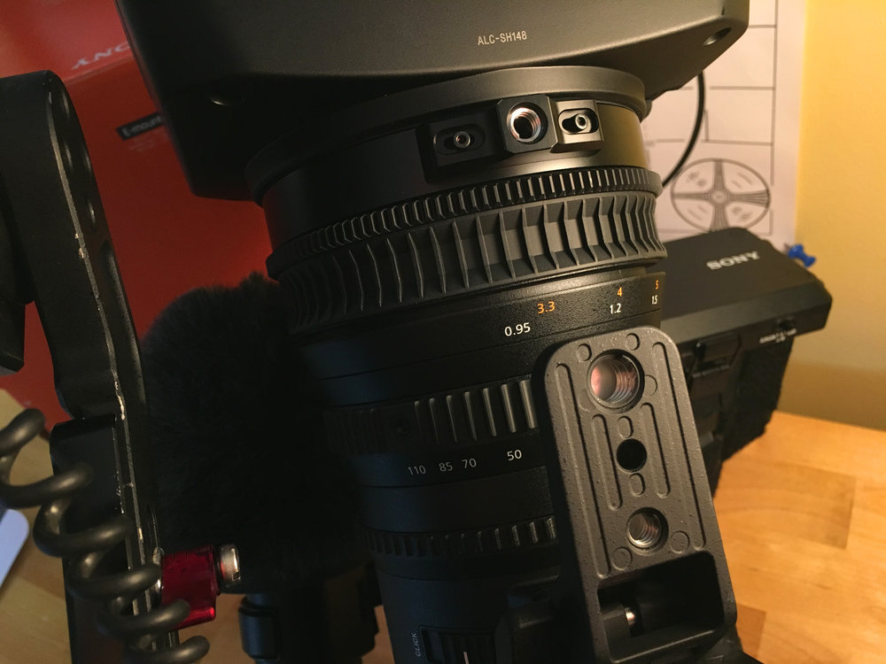 The bottom of the lens features a removable tripod mount and threads at the front for lens support.