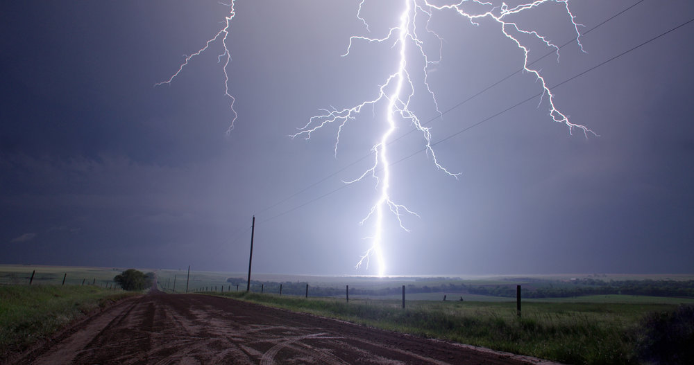An intense bolt of lightning strikes the open prairie in northern Kansas.