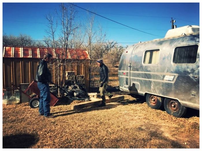 Brian and Dan preparing to move Airstream Overlander