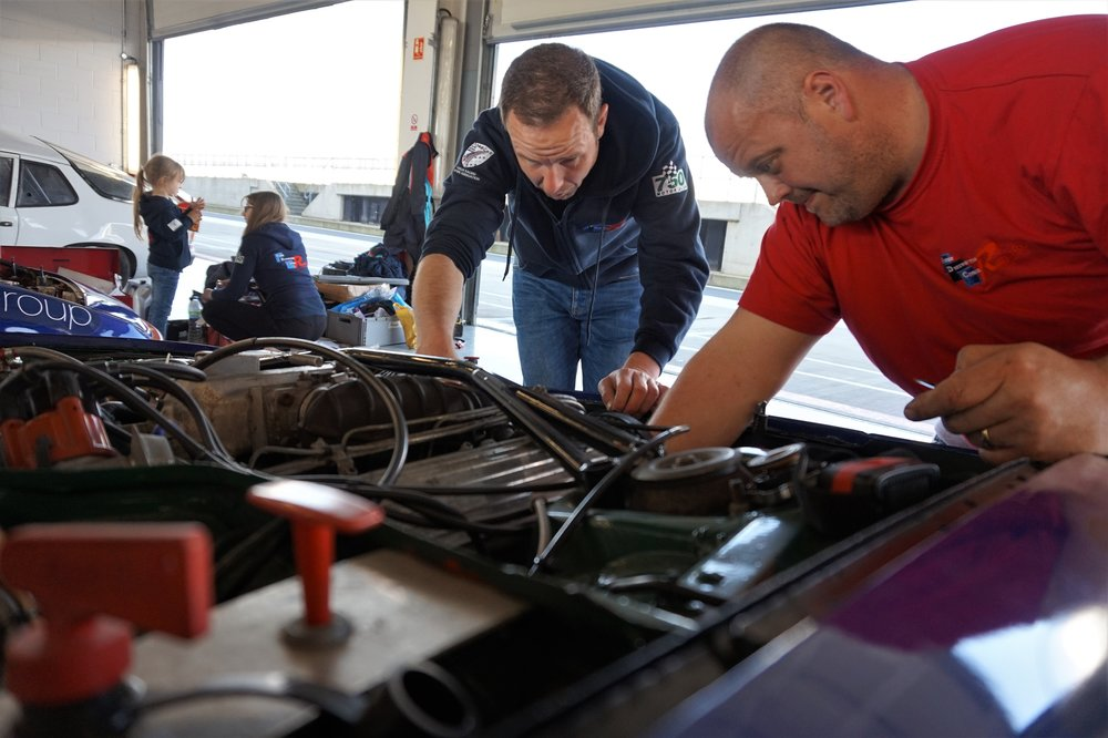 Claire Palser - Sheaky and jason working on car.jpg