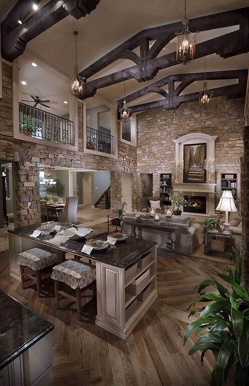 open transitional Living space:  Just like mixed metals you can bring the look of a room together by mixing various woods and stones.
