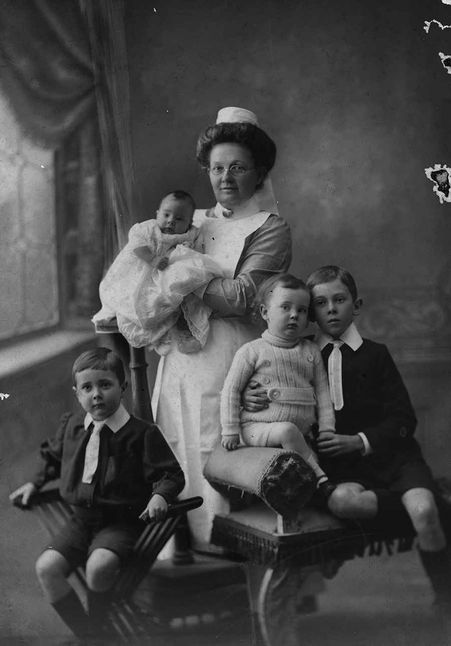Children of Henry Charles Coxen, photographed with their nurse, August 1912. Image no.194883, used courtesy of SLQ.