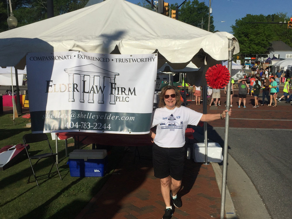 The Elder Law Firm tent was on the corner of Main and Cherokee in downtown Kennesaw.