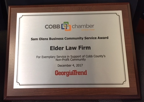 "Elder Law Firm was honored Monday, Dec. 4, with the Sam Olens Business Community Service Award by the Cobb Chamber for ""Exemplary Service in Support of Cobb County's Non-Profit Community."""