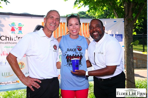 Kennesaw Mayor Derek Easterling and Rev. John Harris of Thankful Baptist Church with a winner after the race.