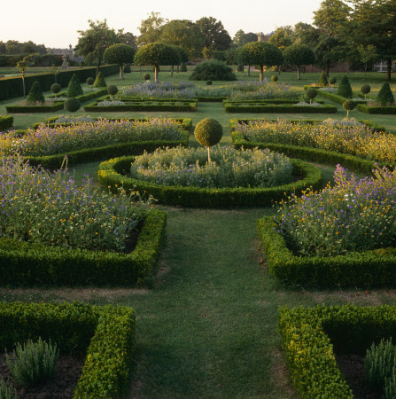 A view down the parterre to several fine examples of topiary in Westbury Court Garden, Gloucestershire