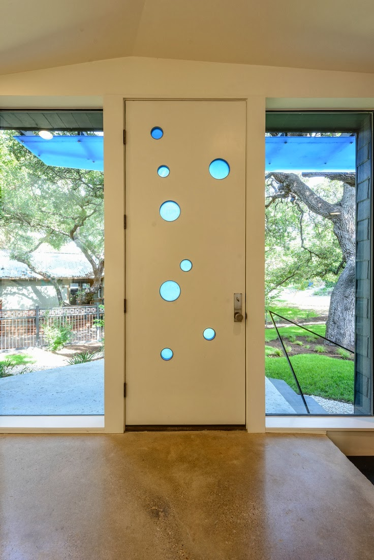 mid-century-modern-front-door-circle-windows-austin-home-tour