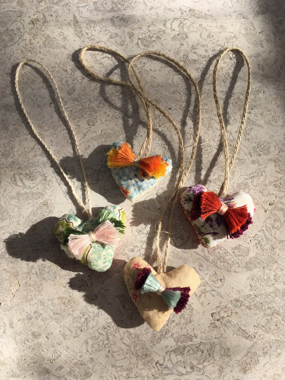 four hanging heart sachets