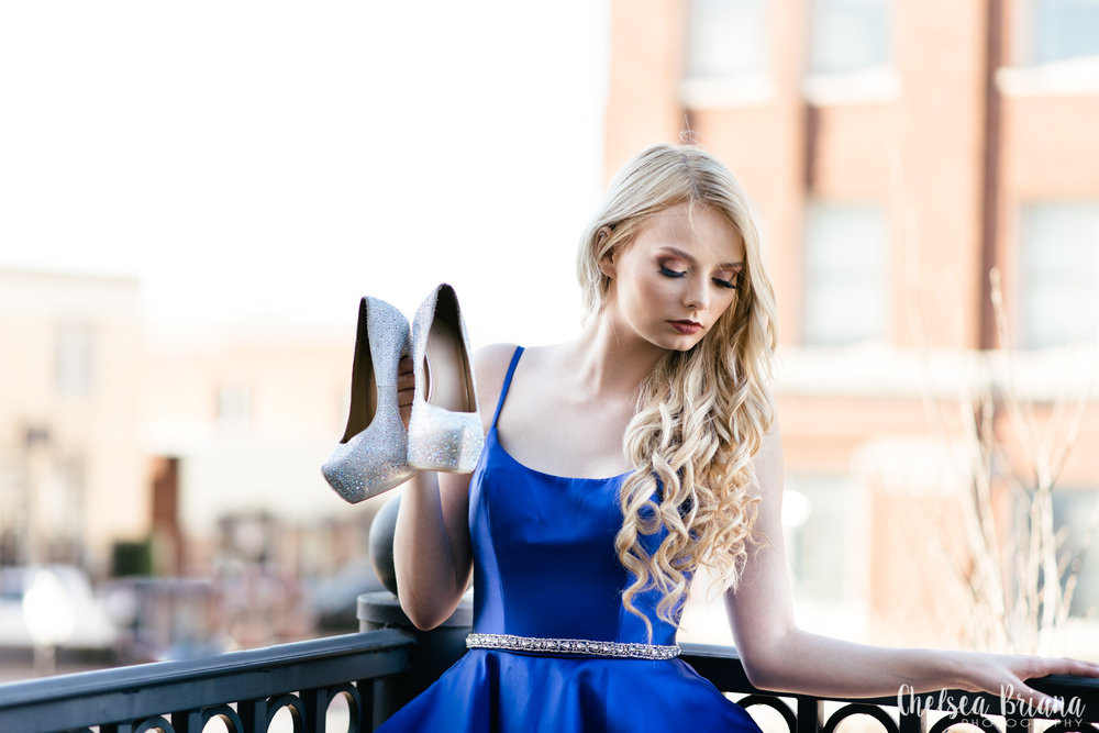 downtown-bryan-texas-senior-model-holding-shoes