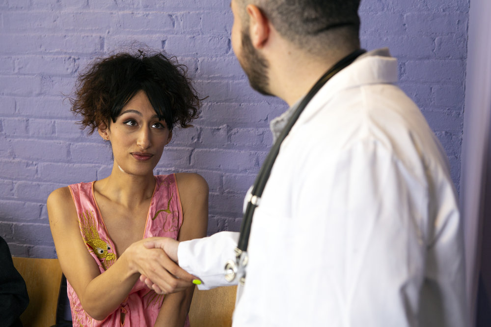 Photo Credit:  The Gender Spectrum Collection . A transgender woman meeting her doctor in the waiting room of a doctor's office.
