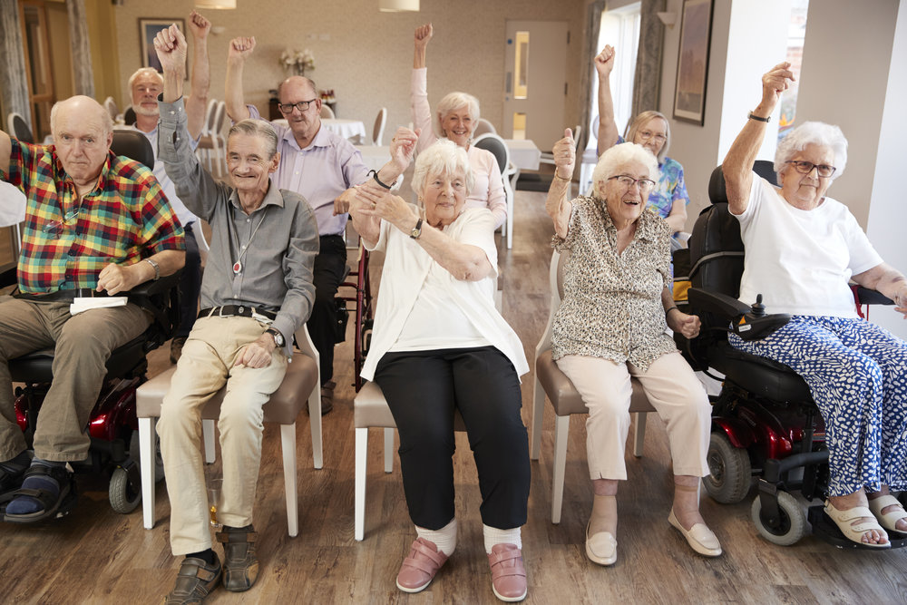group-of-seniors-enjoying-fitness-class-in-DUWY9BE.jpg