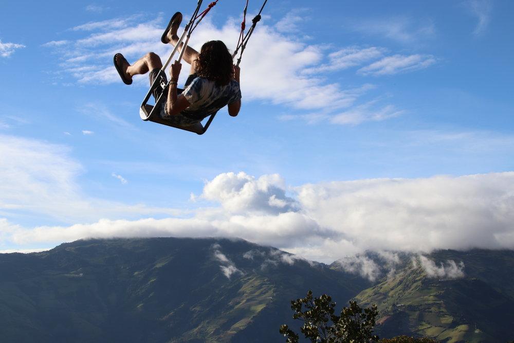 Ryan swinging Banos South America Ecuador