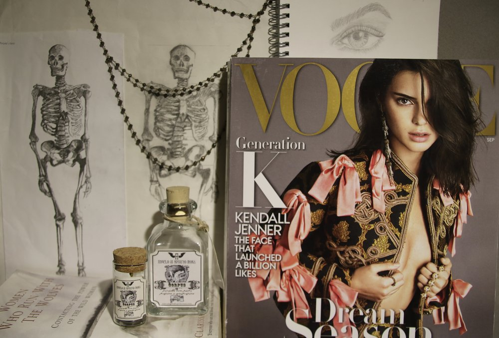 In my inspiration explosion I included a September Vogue issue, my favourite book, jewellery that was packaged in a glass bottle which I found on a trip to Greece, a picture of a skeleton with my drawing next to it, and my drawing of an eye