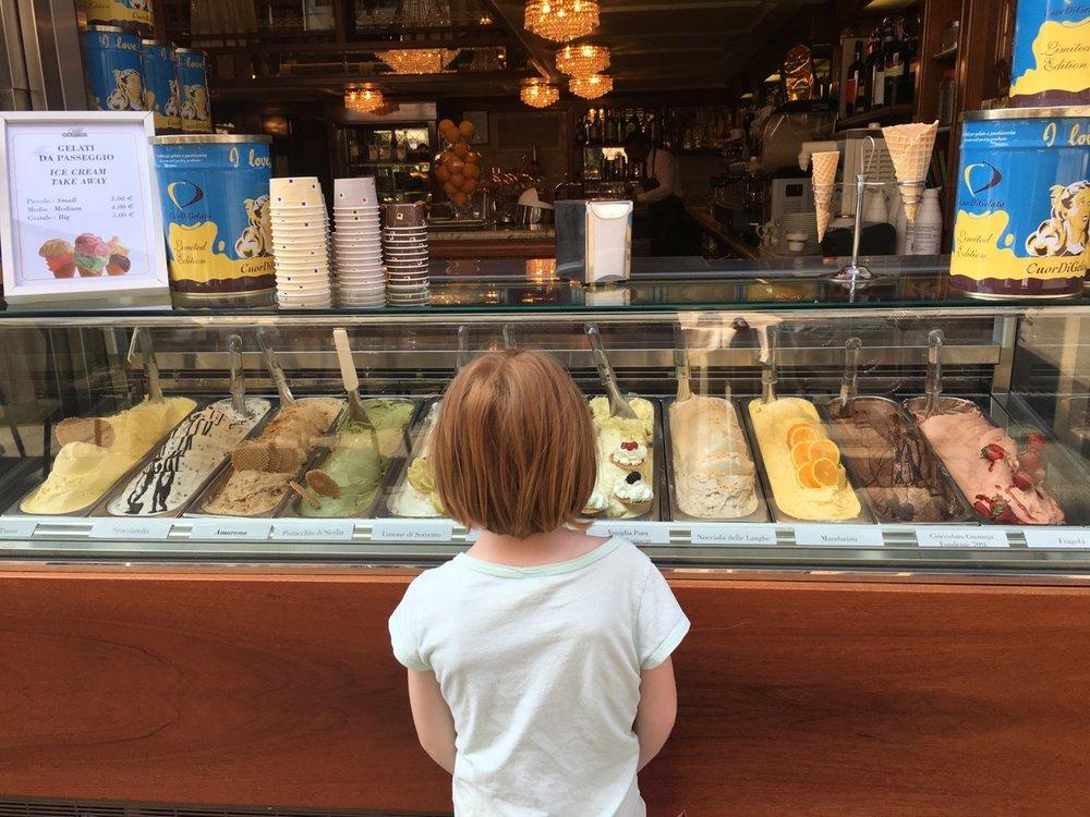 My daughter, contemplating gelato in Milan.