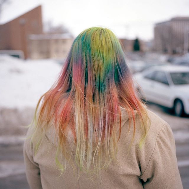 """""""Rissa is a Iraq war veteran and a rainbow hair aficionado. She's one of the only few people from Bismarck actively opposing the pipeline. On her spare time she volunteers at Oceti Oyate camp and makes groovy shirt designs for water protectors. The day we've met Rissa was at Bismarck Court Hall to support Michael Rattler, a fellow protector on his trial. I was surprised to see a war veteran from ND with progressive views and she told me most people that go to wars come back with a different mind set, with an open heart, after seeing so much pain. Her hair describes what a wonderful light she is in such dark times."""" @micotoledo"""
