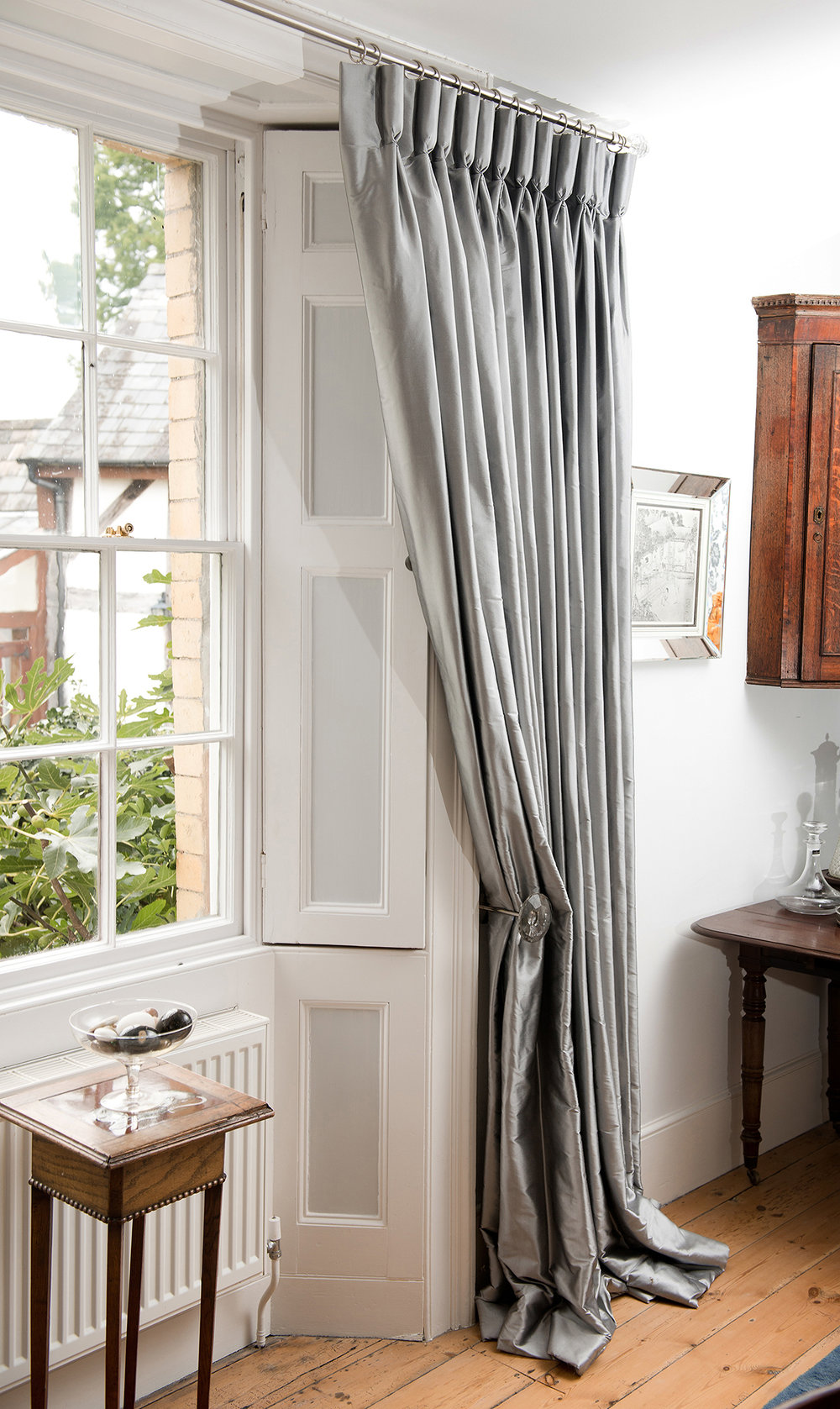 These beautiful, handmade, silk curtains were made for the Georgian windows in a country home. They are elegant and classical and we have made them for homes in Gloucester and Surrey but look equally as luxurious in Chelsea, Fulham and Mayfair.