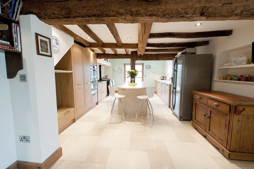 The listed house in Gloucestershire was modernised however, the oak beams were stripped and renovated to great effect and period features enhanced. A new kitchen created out of three rooms. In the kitchen clients requested every modern appliance one would wish for: Aga, double electric cooker, ceramic hob, coffee machine,two sinks, wince fridge……etc! limestone tiles were laid over underfloor heating.