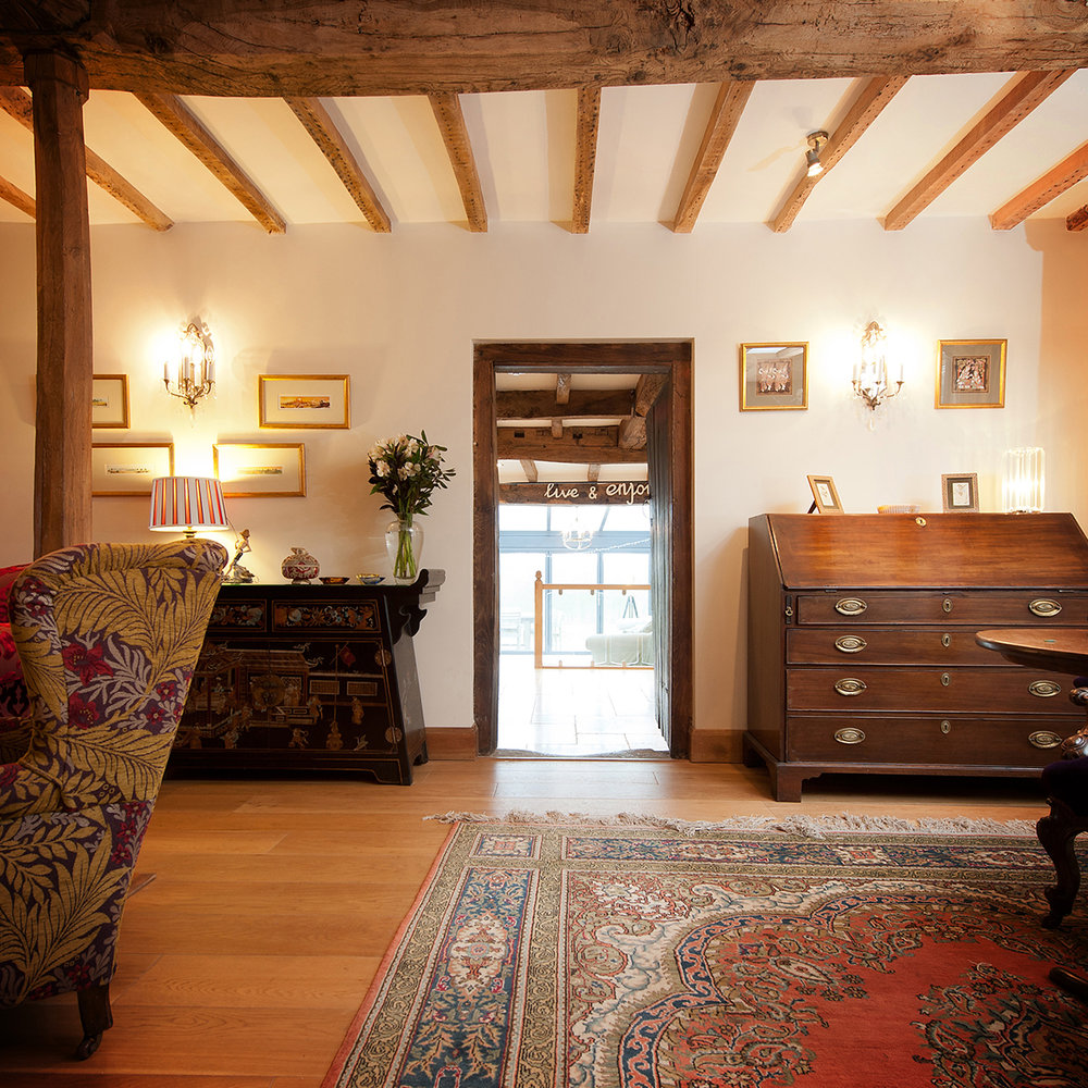 This drawing room had not been touched for years. We completely stripped and restored beams,installed underfloor heating and then oak boards. We then completed the room with mood lighting and bespoke furniture..