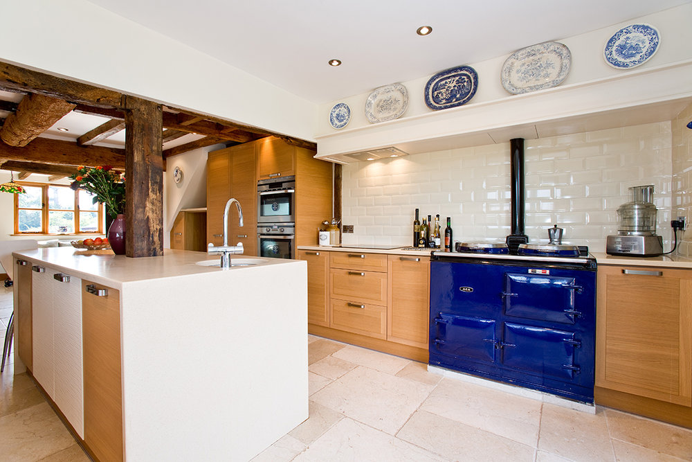 A beautiful bespoke kitchen in Gloucester complete with a lovely blue AGA